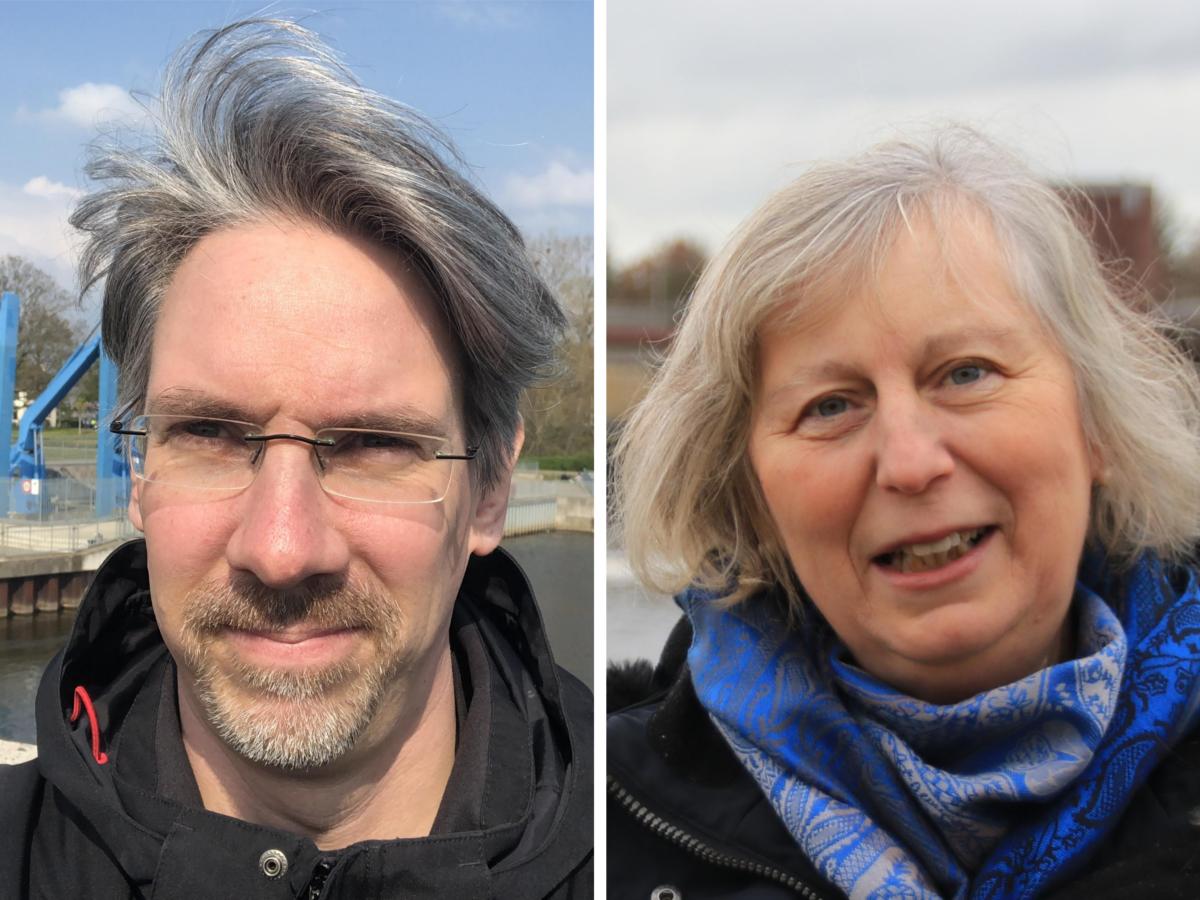 Ein Mann und eine Frau stehen vor dem Weserwehr in Hastedt.
